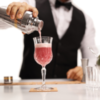 Bartender pouring his signature cocktail in a glass